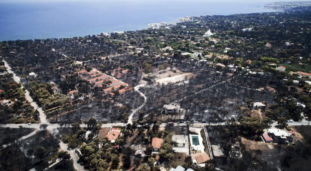 Burnt houses and trees following a wildfire in Mati, east of Athens (Antonis Nikolopoulos/AP)