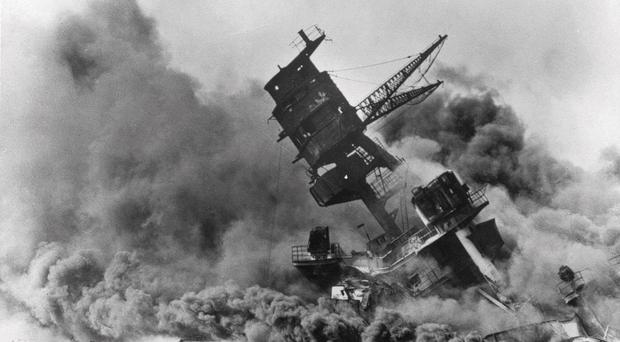 Smoke rises from the battleship USS Arizona as it sinks during a Japanese surprise attack on Pearl Harbour in Hawaii (AP)