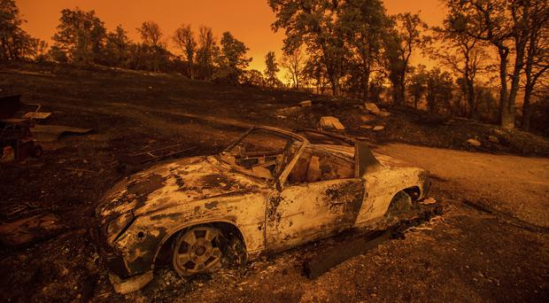 Cars scorched by the Carr Fire rest at a residence in Redding, California (AP Photo/Noah Berger)