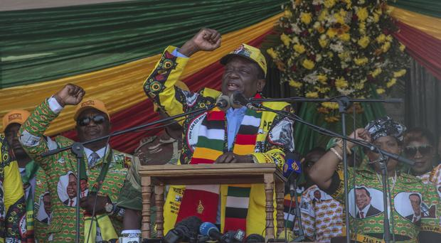 Zimbabwe President Emmerson Mnangagwa speaks at an election rally in Harare (AP)