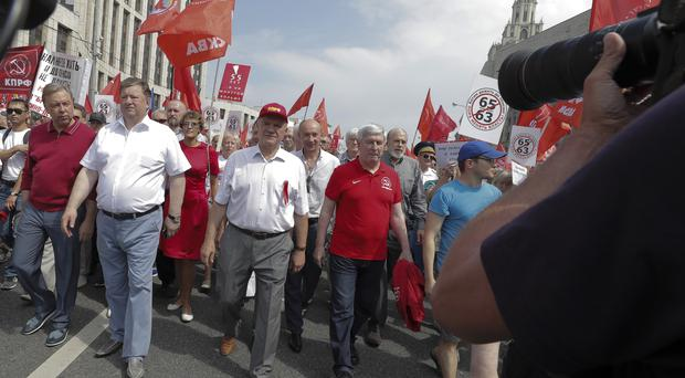 Communist Party leader Gennady Zyuganov leads a march against the pension plans (AP)