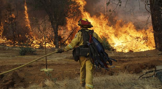 A second firefighter has died fighting a huge blaze near Yosemite National Park (Marcio Jose Sanchez/AP)
