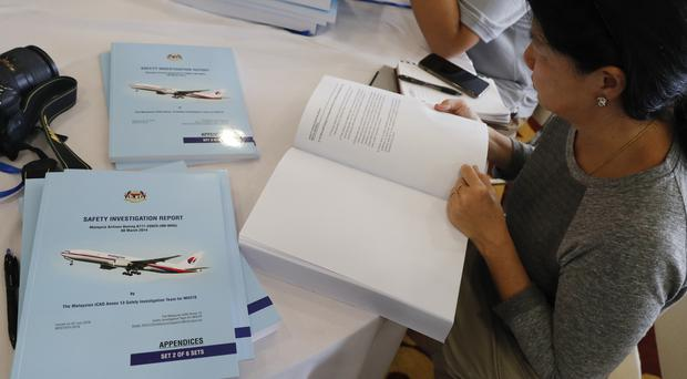 Copies of the final investigation report on missing flight MH370 (Vincent Thian/AP)