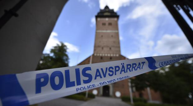 A police cordon near the scene of the robbery at Strangnas Cathedral in Sweden (Pontus Stenberg/TT News Agency via AP)