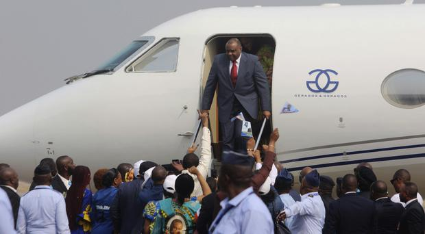 Jean-Pierre Bemba disembarks a private jet upon his arrival at the airport in Kinshasa (John Bompengo/AP)