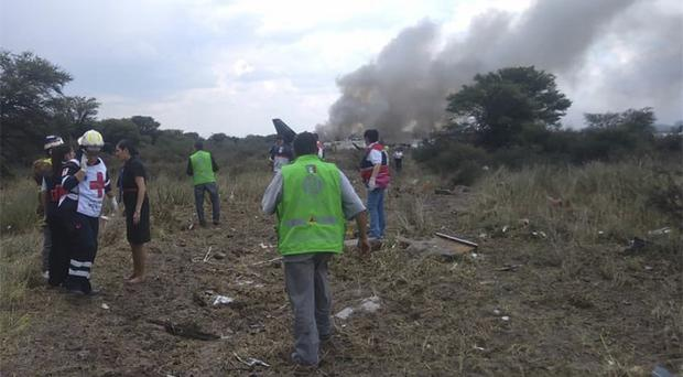 Rescue workers and firefighters at the site of the accident near the airport of Durango, Mexico (Civil Defence Office of Durango Photo via AP)