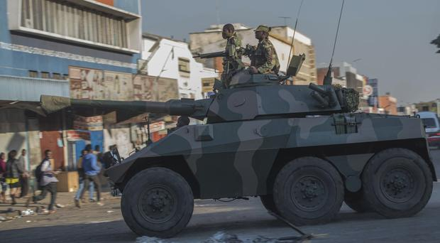 Soldiers have been patrolling the streets in Harare (Mujahid Safodien/AP)