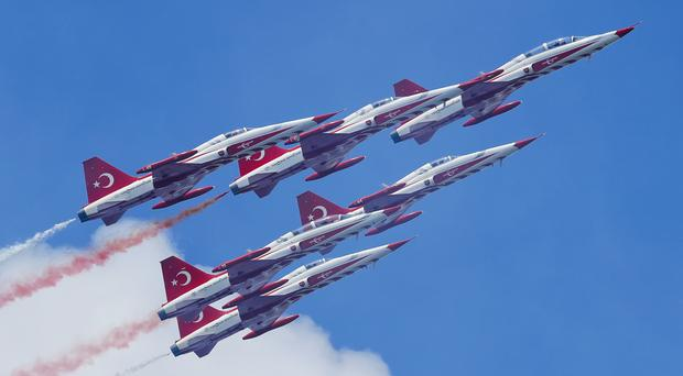 NF-5 fighter jets of the Turkish Stars, Turkey's national aerobatics team (AP)