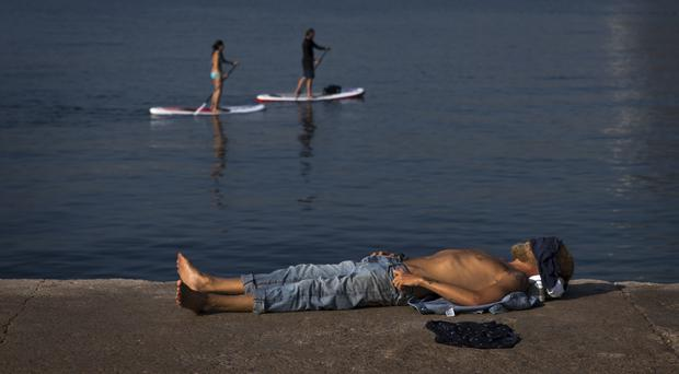 Portugal, Spain and much of southern Europe is being hit by extremely hot temperatures (Emilio Morenatti/AP)