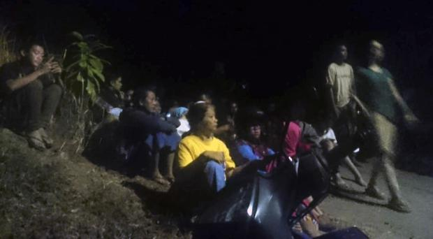 Residents moved to higher ground following an earthquake in Lombok (Sidik Hutomo/AP)