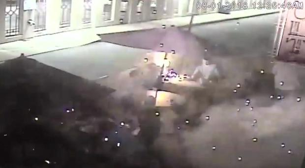 Asheville police released surveillance video showing an SUV whizzing past the patio tables just before the firework explodes (PA Video)