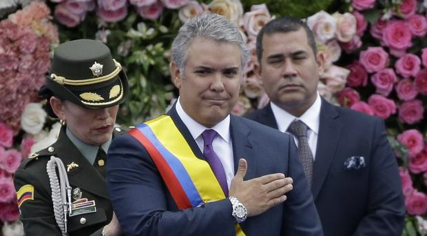 Colombia's President Ivan Duque after receiving the presidential sash during his inauguration ceremony (Fernando Vergara/AP)