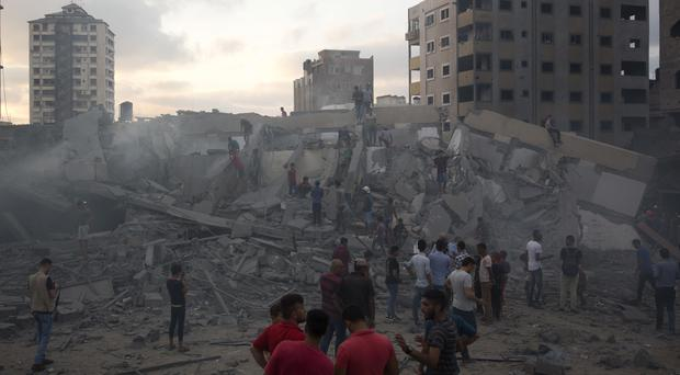 Damage in Gaza City after Israeli airstrikes (Khalil Hamra/AP)