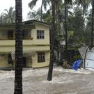 Roads and houses are engulfed in water following heavy rain in Kozhikode, Kerala state, India (AP)