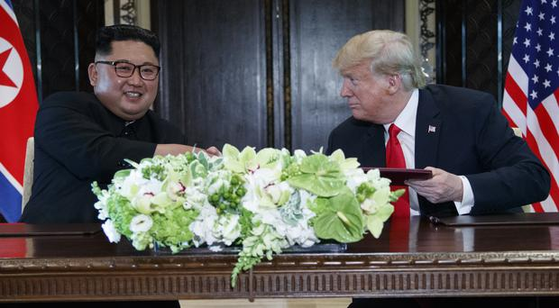 US President Donald Trump and North Korean leader Kim Jong Un (Evan Vucci/AP)