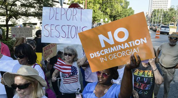 People have been protesting against Attorney General Jeff Sessions' immigration policy (AP Photo/John Amis)