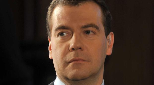 Russian PM Dmitry Medvedev has taken a tough stance against US sanctions on Russia (Jeff Overs/AP)