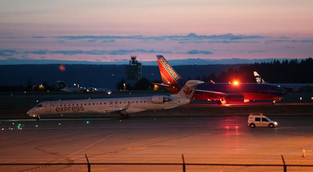 Services at Sea-Tac International Airport were halted (Bettina Hansen /The Seattle Times via AP)