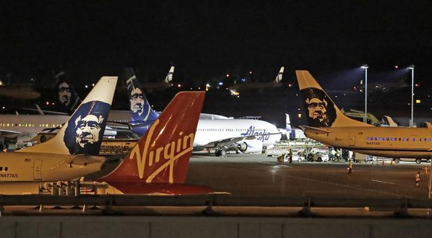 Alaska Airlines and other planes sit on the tarmac at Sea-Tac International Airport (Elaine Thompson/AP)