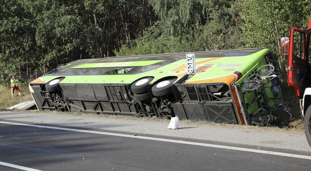 A bus sits beside the Autobahn A 19 in Linstow near Rostock (Bernd Wuestneck/dpa/AP)