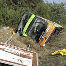 The bus lies beside the A19 in Linstow (Bernd Wuestneck/dpa via AP)