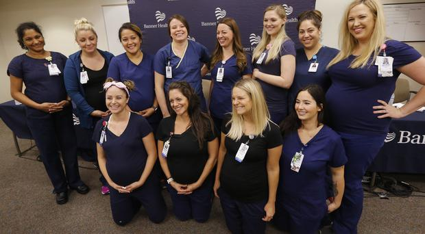 Most of the 16 pregnant nurses who work together in the intensive care unit at Banner Desert Medical Centre in Arizona (Ross D Franklin/AP)