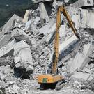Diggers remove debris from the collapsed bridge (Luca Zennaro/ANSA via AP)