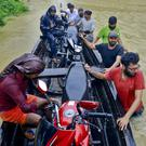Rescuers in Alappuzha district, Kerala state (AP Photo/Tibin Augustine)
