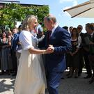 Vladimir Putin dances with Austrian foreign minister Karin Kneissl (Roland Schlager/pool photo via AP)