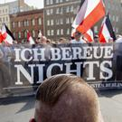 Marchers in Berlin carry a banner reading 'I don't regret anything' (Christoph Soeder/dpa via AP)