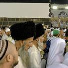 Muslim pilgrims circle around the Kaaba in Mecca (Dar Yasin/AP)