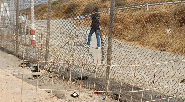 A fence dividing the Spanish enclave of Ceuta and Morocco