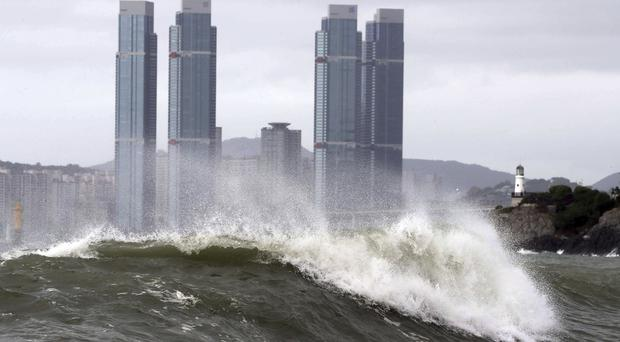 High waves crash onto Haeundae Beach in Busan, South Korea (AP)
