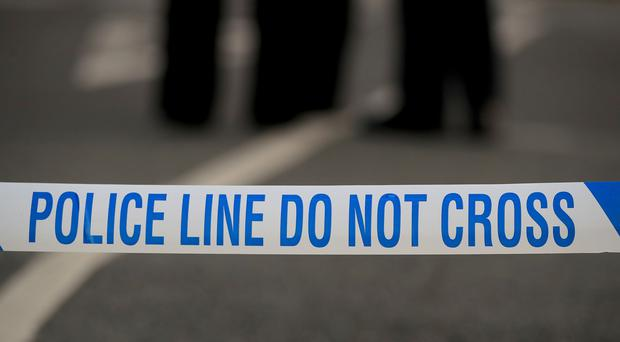 Police tape at a crime scene (Peter Byrne/PA)