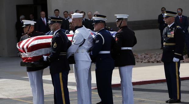 A military honour guard carries the coffin of McCain into North Phoenix Baptist Church (Ross D. Franklin/AP)