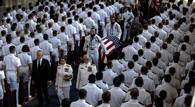 Defence Secretary Jim Mattis leads as the family follows as the casket of Sen.ator John McCain (Mass Communication Specialist 2nd Class Nathan Burke/US Navy via AP)