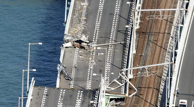 A damaged bridge connecting Kansai International Airport in Osaka, western Japan (Hiroko Harima/Kyodo News via AP)