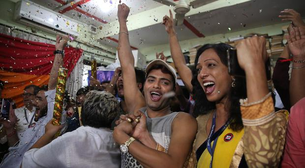 Supporters and members of the LGBT community celebrate after the ruling (Rafiq Maqbool/AP)