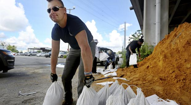 Residents prepare in Charleston (Grace Beahm Alford/The Post And Courier via AP)