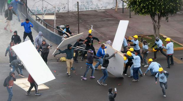 Alianza Lima fans fight with members of an evangelical church (Norman Cordova/Andina News Agency via AP)