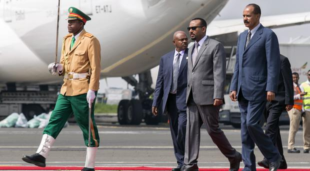 Eritrea's President Isaias Afwerki, right, is welcomed by Ethiopia's Prime Minister Abiy Ahmed, 2nd right, in July for his first visit in 22 years, at the airport in Addis Ababa, Ethiopia (Mulugeta Ayene, AP)