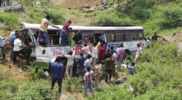 Rescuers pull out passengers (AP Photo)