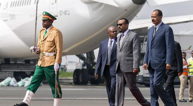 Eritrea's President Isaias Afwerki, right, is welcomed by Ethiopia's Prime Minister Abiy Ahmed (AP Photo/Mulugeta Ayene, File)