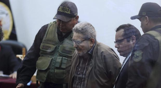 Abimael Guzman, founder and leader of the Shining Path guerrilla movement, arrives in court at a military base in Callao, Peru (Martin Mejia/AP)