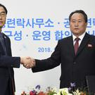 South Korea's Unification Minister Cho Myoung-gyon, left, shakes hands with Ri Son Gwon, chairman of the North's Committee for the Peaceful Reunification (Korea Pool/Yonhap/AP)