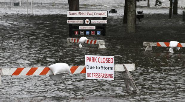 Union Point Park is flooded with rising water from the Neuse and Trent rivers (Gray Whitley/AP)