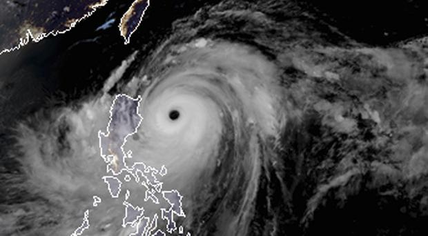 The typhoon has made landfall in the Philippines (RAMMB and CIRA via AP)