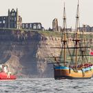 HM Bark Endeavour, a full-scale replica of Captain Cook's ship, sails into Whitby (Danny Lawson/PA)