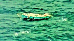 This photo provided by Indian Navy shows the yacht Thuriya of Indian Abhilash Tomy in the Indian Ocean Monday, (Indian Navy via AP)
