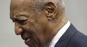 Bill Cosby departs from a sentencing hearing (Matt Rourke/AP)